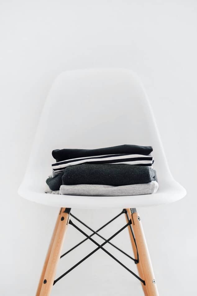 Chair with folded clothes.