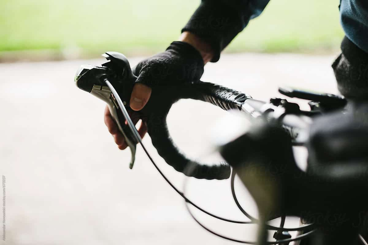 A person pulling the breaks on a bike