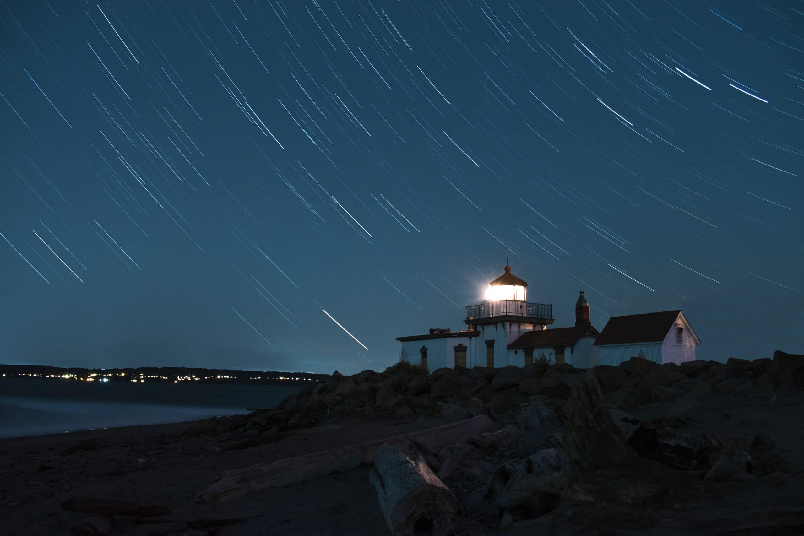 Stars in the night sky over a Seattle lighthouse