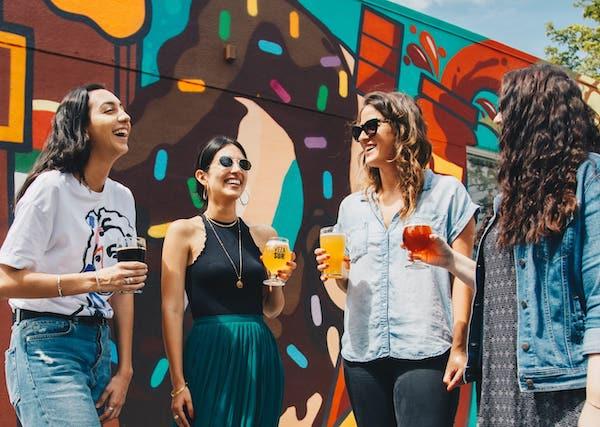 Four women drinking beer